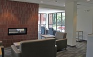 Image of Aspire Hall's Lounge with fireplace